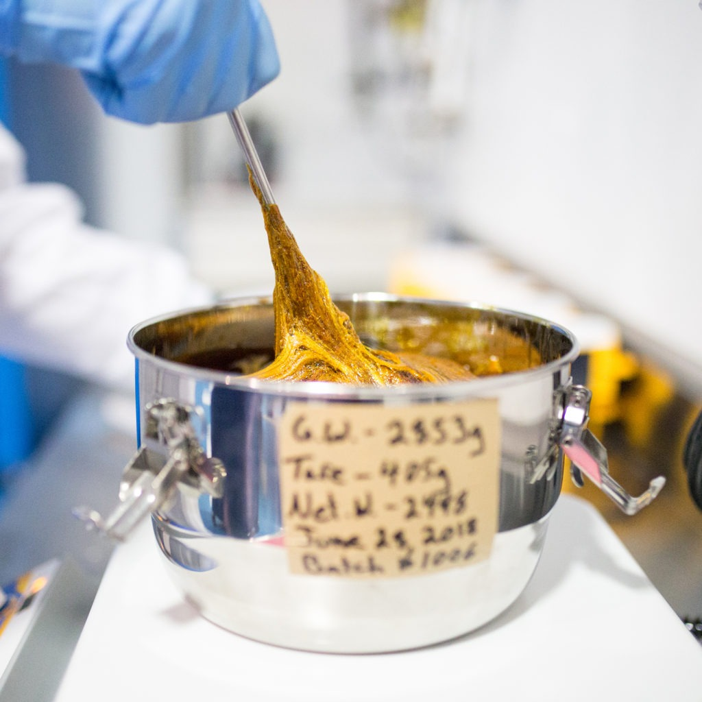 Valens Agritech Cannabis Extracts Closeup in Pot being Stirred