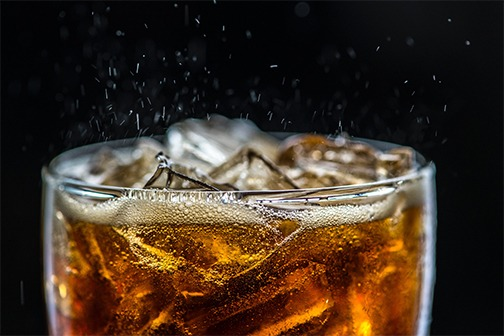 carbonated beverage closeup illustrating carbon dioxide gas leaving solution