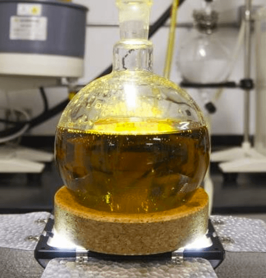 closeup of flask holding extracted cannabis oil