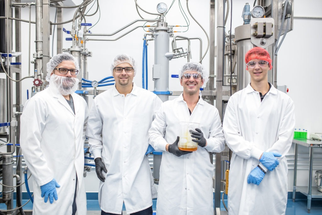 Valens agritech team member photo of four extraction technicians in lab coats