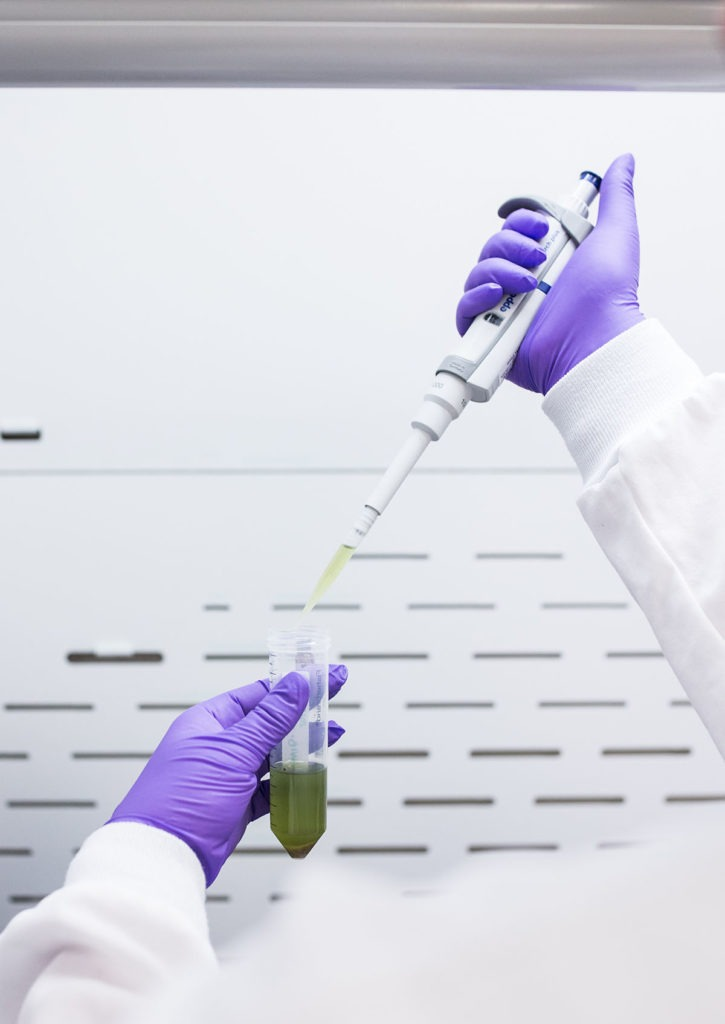Valens lab technician closeup of hands, pipette, and vial; highlighting the importance of safety for formulating vape cartridges
